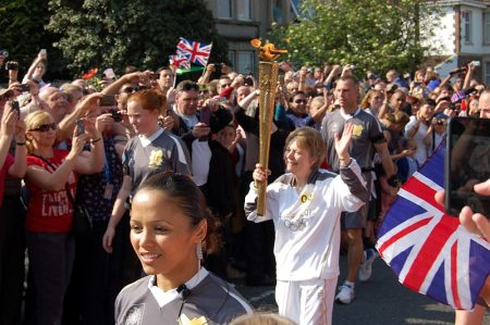 Olympic Torchbearer Corinne Day is welcomed by the crowds in Filton.