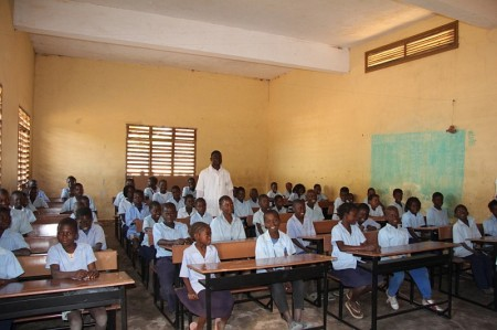 Classroom of children with their new desks at a school in Mozambique.