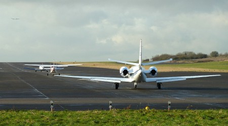 The last three aircraft to take-off from the airfield line up on the runway.