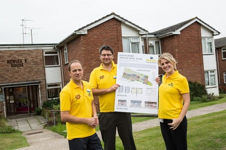 Merlin staff with the plans for the redevelopment of Newleaze House in Filton.