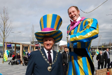 Cllr Ian Boulton with a stilt walker.