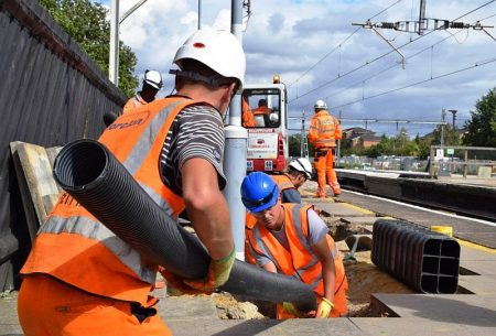 Network Rail workers in action on a station platform.