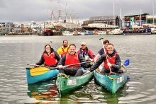 Photo of Village Hotel Club Bristol employees on the water with Young Bristol leaders near Pooles Wharf.