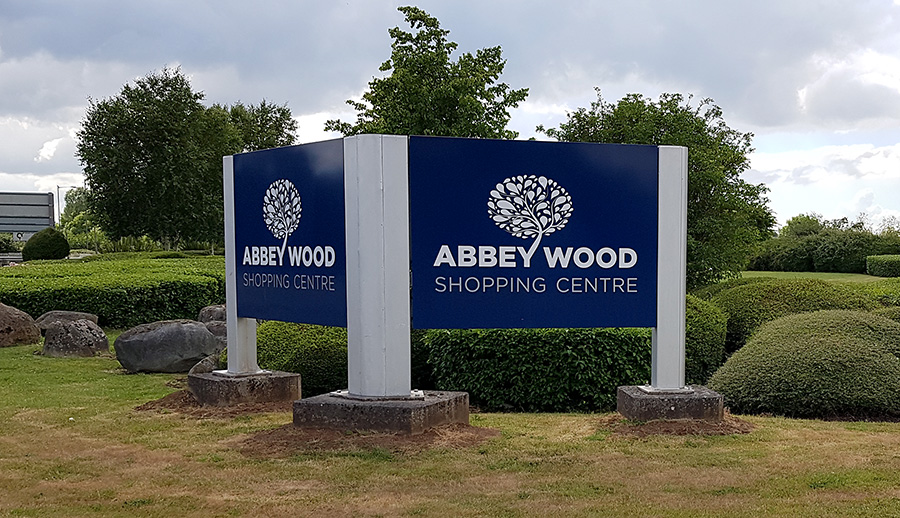 Photo of a sign at the entrance to Abbey Wood Shopping Centre.